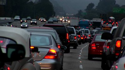 stock-footage-traffic-drives-slowly-on-a-crowded-freeway